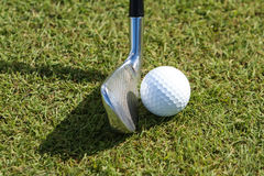 Golf ball and club in grass Stock Photo