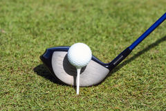 Golf ball and club in grass Royalty Free Stock Images