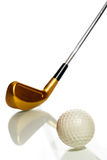 Golf ball and club with reflection Royalty Free Stock Photography