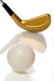 Golf ball and club with reflection Stock Photo