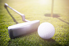 Golf ball. A golf clubs and golf balls in the grass royalty free stock image