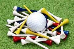 Golf ball and colorful tees Royalty Free Stock Image