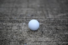 Golf ball on concrete texture. Background stock photo