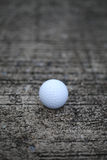Golf ball on concrete texture. Background royalty free stock photos