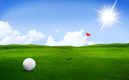 Golf ball on the course. Golf ball in a course with striking colours and Sun Light stock photography