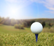 Golf ball on course Stock Photo