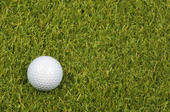 Golf ball on course with green grass. Stock Images