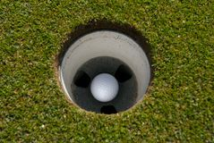 Golf ball in the cup. Birdie? bogey Royalty Free Stock Photos