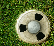 Golf Ball in Cup on Green Royalty Free Stock Photos