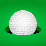 Golf ball in cup Stock Images