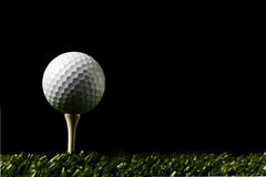 Golf ball on dark backround Royalty Free Stock Photos