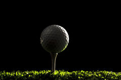 Golf ball on dark backround 2 Royalty Free Stock Image