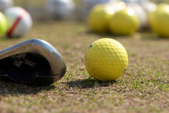 A golf ball and driver Stock Photos