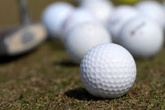 A golf ball and driver Stock Image