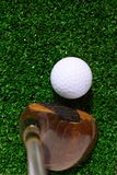 Golf Ball and driver. On green grass Royalty Free Stock Photography