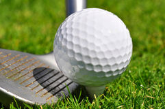 Golf ball and driver. Ready to strike Royalty Free Stock Image