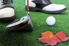 Golf ball driver and shoes Stock Images