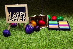 Golf ball with Easter eggs on green grass Royalty Free Stock Photography