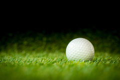 Golf ball. On fairway with black background Stock Photos