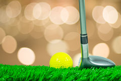 Golf ball and fairway wood on grass Royalty Free Stock Photography