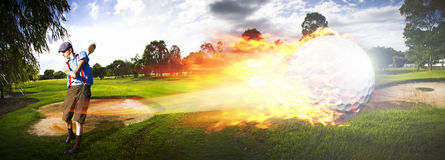 Golf Ball On Fire. Sport Action Landscape Panoramic Of A Golf Player Hitting A Fast Paced Flaming Golf Ball Through The Golf Course Air In A Motion Of Flames And Royalty Free Stock Images