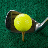 Golf Ball And Five Iron Royalty Free Stock Images