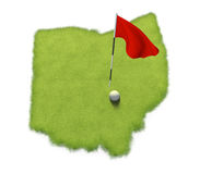 Golf ball and flag pole on course putting green shaped like the state of Ohio Royalty Free Stock Photography