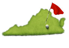 Golf ball and flag pole on course putting green shaped like the state of Virginia Royalty Free Stock Images