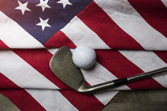 Golf ball with flag of USA. On wood background Royalty Free Stock Photography