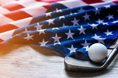 Golf ball with flag of USA on wood table. Close up stock photography