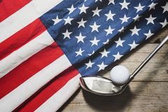 Golf ball with flag of USA on wood table. Top view royalty free stock photos