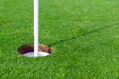 Golf ball and Flagstick of  Manicured grass of putting green. Of golf course Stock Photography