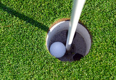 Golf ball and Flagstick of  Manicured grass of putting green. Of golf course Stock Images