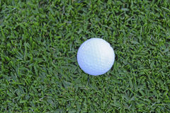 Golf ball and Flagstick of  Manicured grass of putting green. Of golf course Royalty Free Stock Image