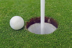 Golf ball and Flagstick of  Manicured grass of putting green. Of golf course Royalty Free Stock Images