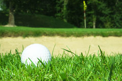Golf ball in front of bunker stock images