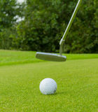 Golf ball on front of a driver Stock Photography