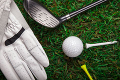 Golf ball, glove and bat on grass! Royalty Free Stock Photo