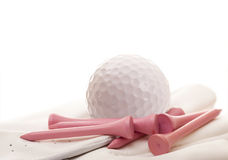 Golf Ball and Glove with Pink Tees Stock Photography
