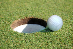 Golf Ball Going in the Hole. Close-up of Golf Ball Going in the Hole stock image