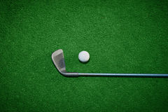Golf ball and Golf Club. On Artificial Grass vignetted Stock Photo