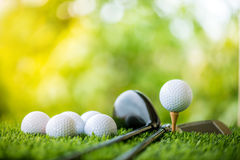 Golf ball with golf club. On grass Royalty Free Stock Photos