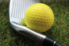 Golf ball golf club grass background. With copy space Royalty Free Stock Photography