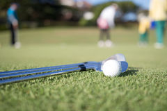 Golf ball and golf club Royalty Free Stock Photography