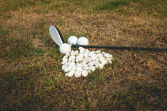 Golf ball and Golf club Stock Images