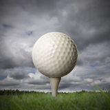 Golf ball on golf tee Royalty Free Stock Photo