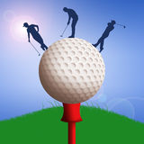 Golf ball with golfers silhouette Royalty Free Stock Photo