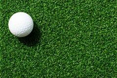 Golf ball on grass. Golf ball on green grass stock photo