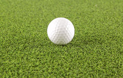 Golf ball on grass. Background Stock Photo