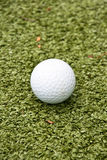 Golf ball on grass Royalty Free Stock Photography